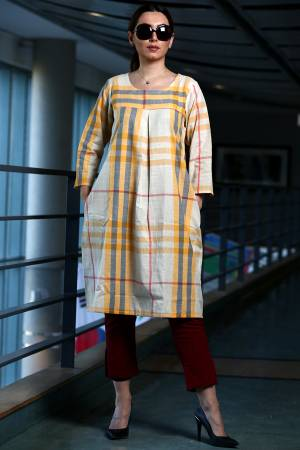 Here Is A Pretty Checks Printed Readymade Kurti In White And Yellow Color Paired With Maroon Colored Bottom. This Kurti Is cotton Based Paired With Khadi Fabricated Bottom.