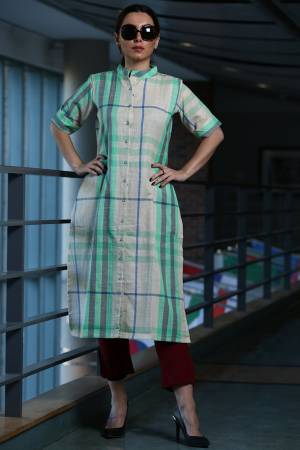 Here Is A Pretty Checks Printed Readymade Kurti In White And Sea Green Color Paired With Maroon Colored Bottom. This Kurti Is cotton Based Paired With Khadi Fabricated Bottom.