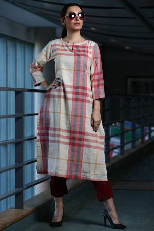 Here Is A Pretty Checks Printed Readymade Kurti In White And Pink Color Paired With Maroon Colored Bottom. This Kurti Is cotton Based Paired With Khadi Fabricated Bottom.