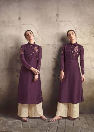 Add This Very Beautiful Designer Readymade Pair Of Kurti And Plazzo To Your Wardrobe In Wine Colored Kurti Paired With Cream Colored Plazzo. This Pretty Embroidered Kurti Is Fabricated On Soft Art Silk Paired With Cotton Fabricated Tone To Tone Embroidered Bottom.