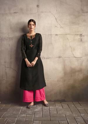 For A Bold And Beautiful Look, Grab This Designer Readymade Kurti In Black Color Paired With Dark Pink Colored Readymade Plazzo. This Pretty Kurti Is Silk Based Paired With Cotton Fabricated Bottom.