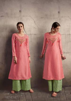 Look Pretty In This Lovely Readymade Pair Of Kurti And Plazzo In Pretty Color Pallete. Its Kurti Is In Pink Color Paired With Contrasting Light Green Colored Bottom. Its Kurti Is Silk based Paired With Cotton Bottom. Both The Top And Bottom Are Beautified With Thread Embroidery.