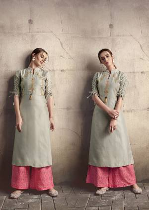 Flaunt Your Rich And Elegant Taste Wearing This Designer Readymade Kurti In Grey Color Paired With Pink Colored Plazzo. This Kurti Is Silk Based Beautified With Thread Work Paired With Cotton Fabricated Bottom Beautified With Tone To Tone Thread Work.