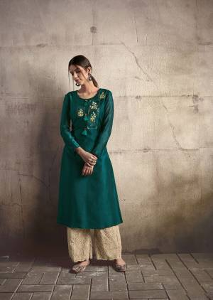 Add This Very Beautiful Designer Readymade Pair Of Kurti And Plazzo To Your Wardrobe In Teal Blue Colored Kurti Paired With Cream Colored Plazzo. This Pretty Embroidered Kurti Is Fabricated On Soft Art Silk Paired With Cotton Fabricated Tone To Tone Embroidered Bottom.