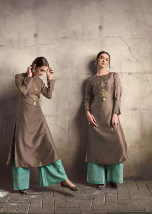 For A Bold And Beautiful Look, Grab This Designer Readymade Kurti In Brown Color Paired With Sea Green Colored Readymade Plazzo. This Pretty Kurti Is Silk Based Paired With Cotton Fabricated Bottom.