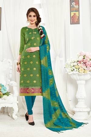 Add This Pretty Dress Material For Your Casual Or Semi-Casual Wear In Green And Blue Color. Its Top And Dupatta Are Fabricated On Banarasi Art Silk Paired With Cotton Bottom. Buy This Dress Material Now.
