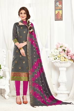 If Those Readymade Suit Does Not Lend You The Desired Comfort Than Grab This Dress Material In Grey  Colored Top Paired With Magenta Colored Bottom And Grey And Magenta Pink Dupatta And Get This Stitched As Per Your Desired Fit And Comfort. Its Top And Dupatta Are Fabricated On Banarasi Art Silk Paired With Cotton Fabricated Bottom.