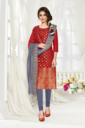 Add This Pretty Dress Material For Your Casual Or Semi-Casual Wear In Red And Grey Color. Its Top And Dupatta Are Fabricated On Banarasi Art Silk Paired With Cotton Bottom. Buy This Dress Material Now.