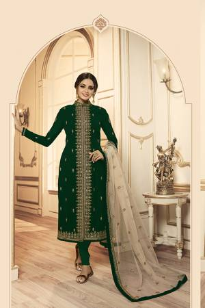 Grab This Beautiful And Heavy Designer Suit With Two Bottoms In Dark Green And Cream Color. Its Embroidered Top Is Fabricated Georgette Satin Paired With One Santoon Plain Bottom And Another Embroidered Lehenga Is Fabricated On Net Paired With Net Fabricated Dupatta. Its Rich Color Pallete And Detailed Embroidery Will Eanr You Lots Of Compliments From Onlookers.