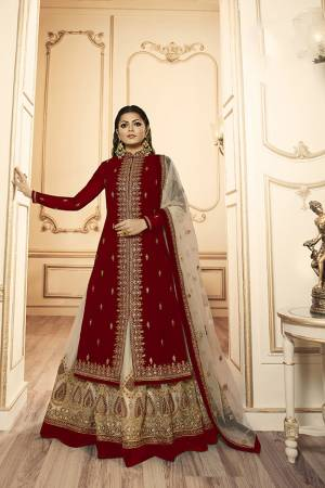 Grab This Beautiful And Heavy Designer Suit With Two Bottoms In Maroon And Cream Color. Its Embroidered Top Is Fabricated Georgette Satin Paired With One Santoon Plain Bottom And Another Embroidered Lehenga Is Fabricated On Net Paired With Net Fabricated Dupatta. Its Rich Color Pallete And Detailed Embroidery Will Eanr You Lots Of Compliments From Onlookers.