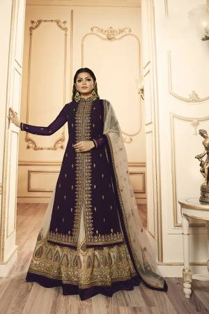 Grab This Beautiful And Heavy Designer Suit With Two Bottoms In Dark Purple And Cream Color. Its Embroidered Top Is Fabricated Georgette Satin Paired With One Santoon Plain Bottom And Another Embroidered Lehenga Is Fabricated On Georgette Paired With Georgette Fabricated Dupatta. Its Rich Color Pallete And Detailed Embroidery Will Eanr You Lots Of Compliments From Onlookers.