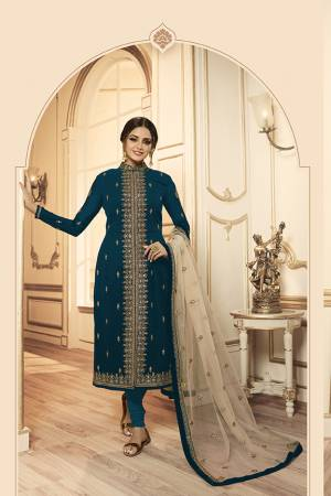 Grab This Beautiful And Heavy Designer Suit With Two Bottoms In Teal Blue And Cream Color. Its Embroidered Top Is Fabricated Georgette Satin Paired With One Santoon Plain Bottom And Another Embroidered Lehenga Is Fabricated On Georgette Paired With Georgette Fabricated Dupatta. Its Rich Color Pallete And Detailed Embroidery Will Eanr You Lots Of Compliments From Onlookers.