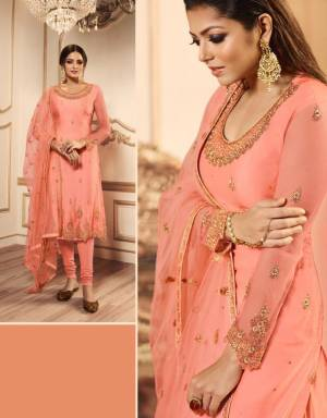 A Must Have Shade In Every Womens Wardrobe Is Here With This Designer Indo-Western Suit In Peach Color Which Comes With Two Bottom. Its pretty Embroidered Top, Lehenga And Dupatta are Net Based Paired With A Santoon Fabricated Bottom.