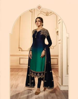 Very Beautiful Shaded Indo-Western Suit Is Here In Navy Blue And Teal Green color. Its Beautiful Top IS Fabricated On Georgette Satin Paired With santoon Bottom, Georgette Fabricated Lehenga And Dupatta.Buy This Designer Two In One Suit Now.