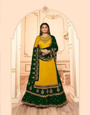Get Ready For The Upcoming Festive And Wedding Season With This Designer Two In One Indo Western Suit In Yellow And Dark Green. This Its Embroidered Top Is Georgette Satin Based Paired With Santoon Bottom And Georgette Fabricated Lehenga And Dupatta.