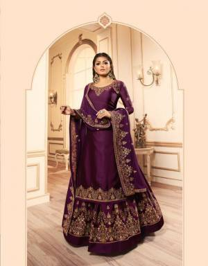 Here Is A Beautiful Heavy Designer Indo-Western Suit In Purple Color. This Pretty Suit Comes With Two Bottoms So That You can Pair As Per The Occasion. It Top IS Fabricated On Georgette Satin Paired With Santoon Bottom And Georgette Fabricated Lehenga And Dupatta. Buy Now.