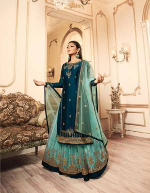 Pretty Shades Of Blue Are Here With This Designer Heavy Indo-Western Suit In Navy Blue And Sky Blue Color. Its Top IS Fabricated On Satin Georgette Paired With Two Bottoms, One In Santoon And Another In Net Fabricated Lehenga And Net Dupatta. All Its Fabric Are Durable, Light Weight And Easy To Carry All Day Long.