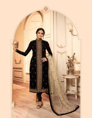 Very Beautiful Shaded Indo-Western Suit Is Here In Black And Cream color. Its Beautiful Top IS Fabricated On Georgette Satin Paired With santoon Bottom, Net Fabricated Lehenga And Dupatta.Buy This Designer Two In One Suit Now.