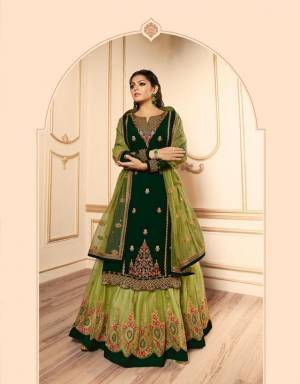Pretty Shades Of Green Are Here With This Designer Heavy Indo-Western Suit In Dark Green And Light Green Color. Its Top IS Fabricated On Satin Georgette Paired With Two Bottoms, One In Santoon And Another In Net Fabricated Lehenga And Net Dupatta. All Its Fabric Are Durable, Light Weight And Easy To Carry All Day Long.