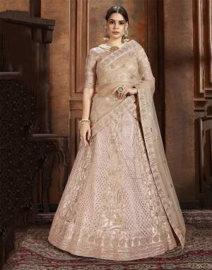 Here Is Very Elegant Looking Heavy Designer Lehenga Choli For The Upcoming Wedding Season In Pretty Rose Gold Color. This Lehenga , Choli And Dupatta Are Fabricated On Net Beautified With Heavy Detailed Embroidery. Buy Now.