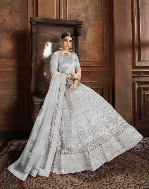 Flaunt Your Rich And Elegant Taste Wearing This Heavy Designer Lehenga Choli In Light Grey Color. This Beautifully Embroidered Heavy Lehenga Choli And Its Dupatta Are Fabricated On Net. Its Elegant Color And Detailed Embroidery Will Earn You Lots Of Compliments From Onlookers.