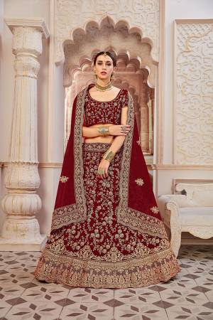 Get Ready For Your D-Day With This Heavy Designer Lehenga Choli In?All Over Maroon Color. This Heavy Embroidered Lehenga Choli Is Fabricated On Velvet Paired With Net Fabricated Dupatta. It Is Beautified With Heavy Coding Jari Embroidery. Buy This Bridal Lehenga Now.