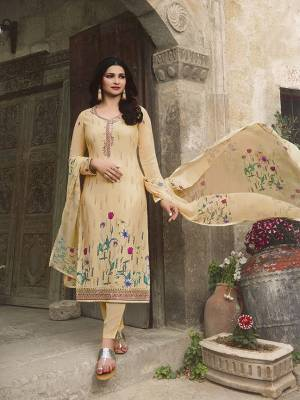Here Is A Very Beautiful Designer Straight Suit In Cream Color. This Pretty Top Is Fabricated On Crepe Paired With Santoon Fabricated Bottom And Chiffon Fabricated Dupatta. It Is Beautified With Floral Printed And Embroidery. Buy Now.