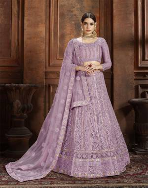 Beautiful And Elegant Looking Shade Is Here To Add Into Your Wardrobe With This Heavy Designer Lehenga Choli In Lavendor Color. This Lehenga Choli And Dupatta Are Fabricated On Net Beautified With Heavy Detailed Embroidery. Buy Now.