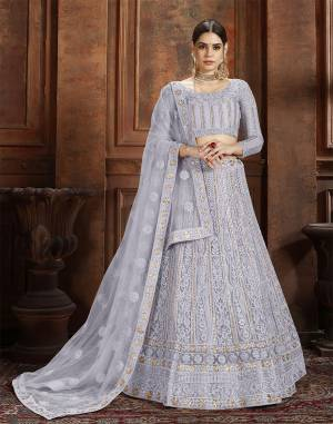 Flaunt Your Rich And Elegant Taste Wearing This Heavy Designer Lehenga Choli In Grey Color. This Beautifully Embroidered Heavy Lehenga Choli And Its Dupatta Are Fabricated On Net. Its Elegant Color And Detailed Embroidery Will Earn You Lots Of Compliments From Onlookers.
