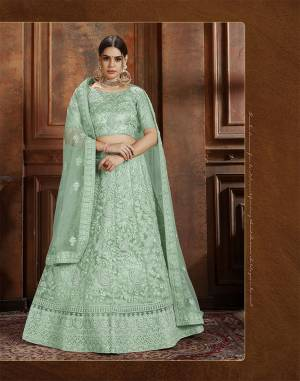 Beautiful And Elegant Looking Shade Is Here To Add Into Your Wardrobe With This Heavy Designer Lehenga Choli In Sea Green Color. This Lehenga Choli And Dupatta Are Fabricated On Net Beautified With Heavy Detailed Embroidery. Buy Now.