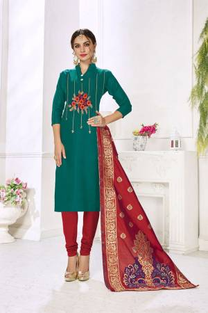 Celebrate This Festive Season With Beauty And Comfort Wearing This Designer Straight Suit In Teal Blue Color Paired With Contrasting Red Colored Bottom And Dupatta. This Dress Material Is Cotton based Paired With Jacquard Silk Fabricated Dupatta. Buy Now.