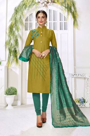 Celebrate This Festive Season With Beauty And Comfort Wearing This Designer Straight Suit In Olive Green Color Paired With Contrasting Navy Blue Colored Bottom And Dupatta. This Dress Material Is Cotton based Paired With Jacquard Silk Fabricated Dupatta. Buy Now.