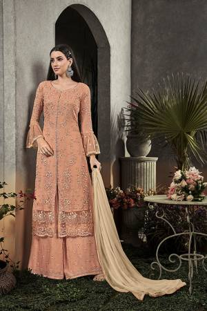 Here Is A Very Beautiful Designer Straight Suit In Pretty Peach Color Paired With Cream Colored Dupatta. Its Pretty Embroidered Top And Bottom Are Fabricated On Georgette Paired With Chiffon Fabricated Dupatta. It Is Light In Weight And Easy To Carry All Day Long.