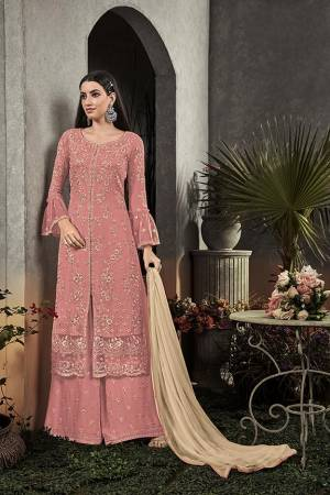 Here Is A Very Beautiful Designer Straight Suit In Pretty Pink Color Paired With Cream Colored Dupatta. Its Pretty Embroidered Top And Bottom Are Fabricated On Georgette Paired With Chiffon Fabricated Dupatta. It Is Light In Weight And Easy To Carry All Day Long.