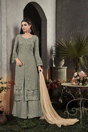 Here Is A Very Beautiful Designer Straight Suit In Pretty Teal Grey Color Paired With Cream Colored Dupatta. Its Pretty Embroidered Top And Bottom Are Fabricated On Georgette Paired With Chiffon Fabricated Dupatta. It Is Light In Weight And Easy To Carry All Day Long.