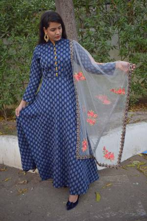 Grab This Designer Floor Length Readymade Suit In Navy Blue Color Paired With Grey Colored Dupatta. Its Weaved Top Is Fabricated On Cotton Jacquard Paired With Santoon Bottom And Net Fabricated Embroidered Dupatta.