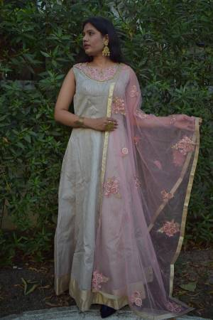 Flaunt Your Rich And Elegant Taste In Subtle Color Pallete With This Readymade Suit In Grey Color Paired With Baby Pink Colored Dupatta. Its Top Is Silk Based Paired With Santoon Bottom And Net Fabricated Dupatta.