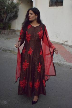 Enhance Your Personality Wearing This Readymade Floor Length Suit In Brown Color Paired With Red Colored Dupatta. This Suit Is Fabricated on Art Silk Paired With Santoon Bottom And Net Fabricated Dupatta. It IS Beautified With Contrasting Thread Work.