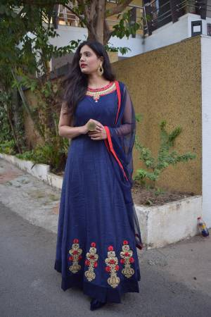 Grab This Designer Floor Length Readymade Suit In Navy Blue Color Paired With Grey Colored Dupatta. Its Embroidered Top Is Fabricated On Art Silk Paired With Santoon Bottom And Net Fabricated Embroidered Dupatta.
