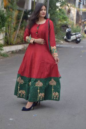 Enhance Your Personality Wearing This Readymade Floor Length Suit In Maroon And Green Color Paired With Maroon Colored Bottom And  Dupatta. This Suit Is Fabricated on Art Silk Paired With Santoon Bottom And Net Fabricated Dupatta. It IS Beautified With Contrasting Thread Work.