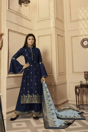 Get Ready For The Upcoming Festive And Wedding Season With This Very Beautiful Designer Straight Suit In Navy Blue Color Paired With Grey Colored Dupatta. Its Embroidered Top Is Satin Georgette Based Paired With Santoon Bottom And Net Fabricated Heavy Embroidered Dupatta. Buy This Lovely Suit Now.