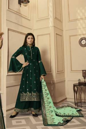 Get Ready For The Upcoming Festive And Wedding Season With This Very Beautiful Designer Straight Suit In Dark Green Color Paired With Light Green Colored Dupatta. Its Embroidered Top Is Satin Georgette Based Paired With Santoon Bottom And Net Fabricated Heavy Embroidered Dupatta. Buy This Lovely Suit Now.