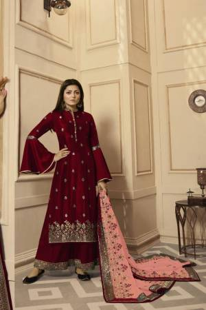 Get Ready For The Upcoming Festive And Wedding Season With This Very Beautiful Designer Straight Suit In Maroon Color Paired With Peach Colored Dupatta. Its Embroidered Top Is Satin Georgette Based Paired With Santoon Bottom And Net Fabricated Heavy Embroidered Dupatta. Buy This Lovely Suit Now.