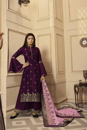Get Ready For The Upcoming Festive And Wedding Season With This Very Beautiful Designer Straight Suit In Wine Color Paired With Lilac Colored Dupatta. Its Embroidered Top Is Satin Georgette Based Paired With Santoon Bottom And Net Fabricated Heavy Embroidered Dupatta. Buy This Lovely Suit Now.