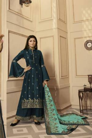 Get Ready For The Upcoming Festive And Wedding Season With This Very Beautiful Designer Straight Suit In Teal Blue Color Paired With Sea Green Colored Dupatta. Its Embroidered Top Is Satin Georgette Based Paired With Santoon Bottom And Net Fabricated Heavy Embroidered Dupatta. Buy This Lovely Suit Now.