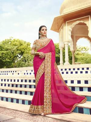 Shine Bright Wearing This Attractive Designer Saree In Rani Pink Color Paired With Cream Colored Blouse. This Saree Is Fabricated On Georgette Paired With Art Silk Fabricated Blouse. Its Blouse And Saree Border Are Beautified With Embroidery Giving An Attractive Look.