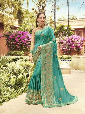 Here Is A Very Beautiful Heavy Designer Saree In Sea Green Color Paired With Cream Colored Blouse. This Saree And Blouse are Silk Based Beautified With Heavy Embroidery Which also Gives A Rich Look To Your Personality.