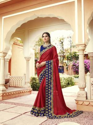 Shine Bright Wearing This Attractive Designer Saree In Red Color Paired With Royal Blue Colored Blouse. This Saree Is Fabricated On Georgette Paired With Art Silk Fabricated Blouse. Its Blouse And Saree Border Are Beautified With Embroidery Giving An Attractive Look.
