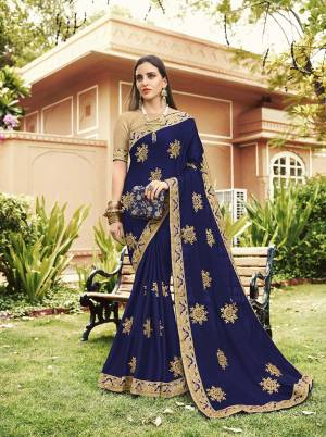 Celebrate This Festive Season With Beauty And Comfort Wearing This Heavy Designer Saree In Royal Blue Color Paired With Cream Colored Blouse. This Saree Is Georgette Based Paired With art Silk Fabricated Blouse. It Is Light In Weight And Easy To Carry All Day Long.