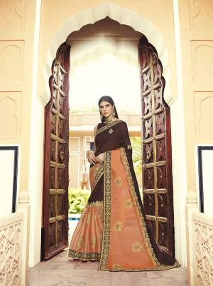 Here Is A Very Beautiful Heavy Designer Saree In Brown And Orange Color Paired With Brown Colored Blouse. This Saree And Blouse are Silk Based Beautified With Heavy Embroidery Which also Gives A Rich Look To Your Personality.